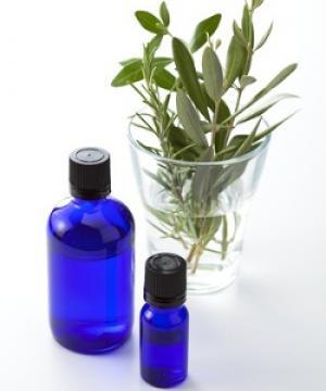 blue essential oil bottles and olive leaves