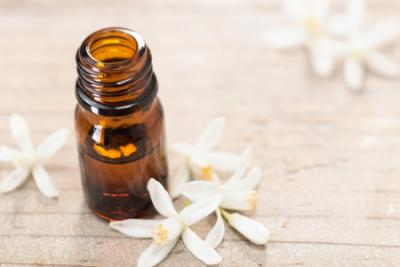Neroli essential oil bottle and flowers