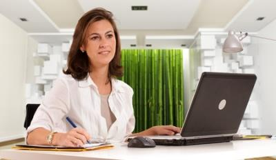 woman working at desk with computer