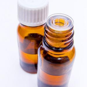 Brown glass essential oil bottles with white lids